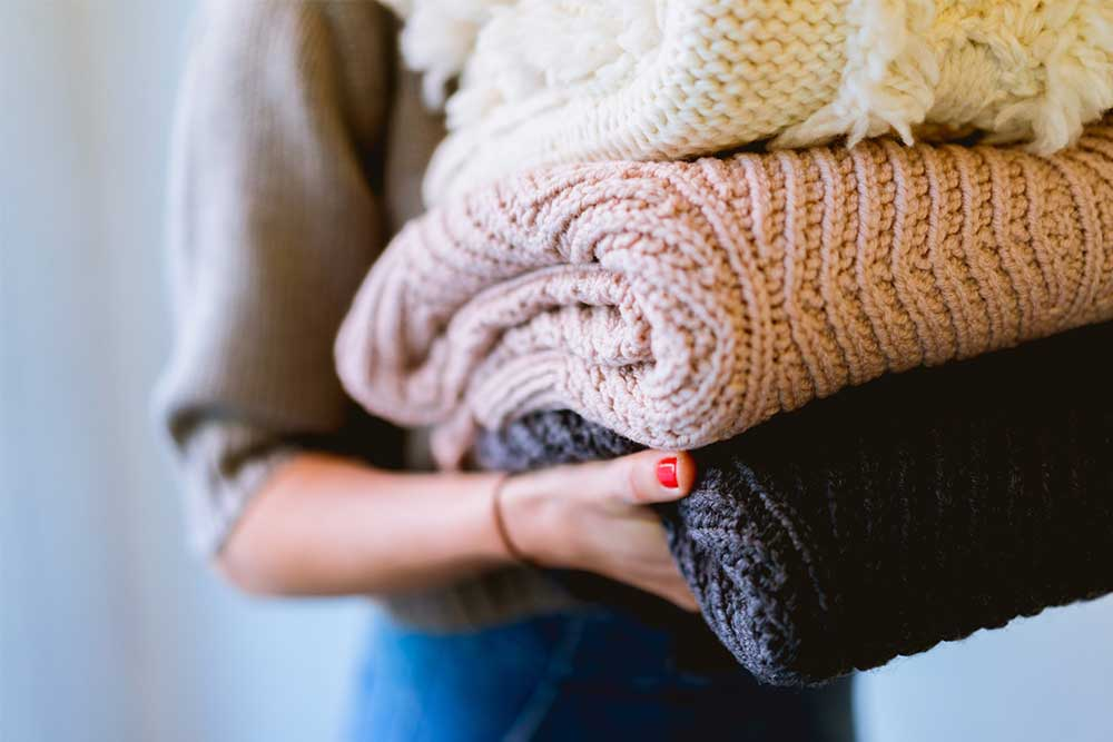 9 sustainable sweaters that make it OK summer's over